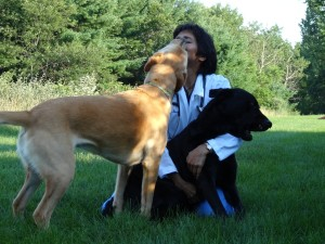 Dr. Barrett enjoying a moment with her dogs.